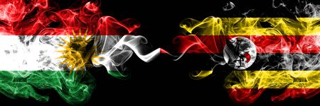 Kurdistan vs Uganda, Ugandan smoke flags placed side by side. Thick colored silky smoke flags of Kurds and Uganda, Ugandan