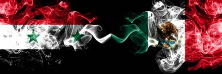 Syria vs Mexico, Mexican smoke flags placed side by side. Thick colored silky smoke flags of Syrian and Mexico, Mexican Stock Photo