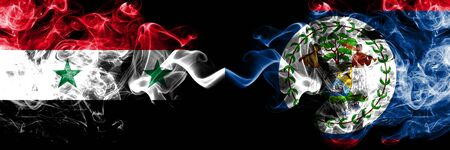 Syria vs Belize, Belizean smoke flags placed side by side. Thick colored silky smoke flags of Syrian and Belize, Belizean