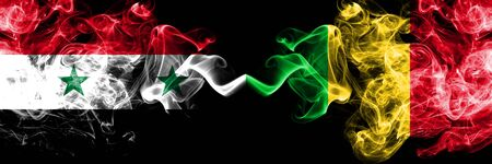Syria vs Mali smoke flags placed side by side. Thick colored silky smoke flags of Syrian and Mali Stock Photo