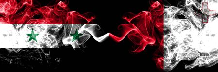 Syria vs Malta, Maltese smoke flags placed side by side. Thick colored silky smoke flags of Syrian and Malta, Maltese
