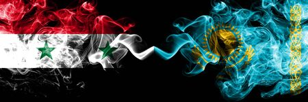 Syria vs Kazakhstan, Kazakhstani smoke flags placed side by side. Thick colored silky smoke flags of Syrian and Kazakhstan, Kazakhstani Reklamní fotografie
