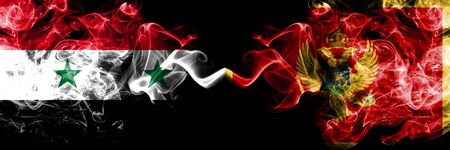 Syria vs Montenegro, Montenegrin smoke flags placed side by side. Thick colored silky smoke flags of Syrian and Montenegro, Montenegrin Stock Photo