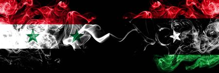 Syria vs Libya, Libyan smoke flags placed side by side. Thick colored silky smoke flags of Syrian and Libya, Libyan
