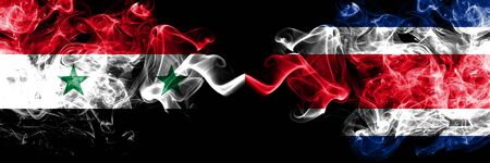 Syria vs Costa Rica smoke flags placed side by side. Thick colored silky smoke flags of Syrian and Costa Rica