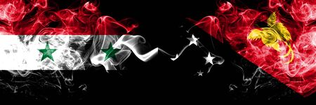 Syria vs Papua New Guinea smoke flags placed side by side. Thick colored silky smoke flags of Syrian and Papua New Guinea Stock Photo