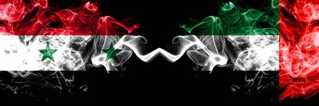 Syria vs United Arab Emirates, Emirati smoke flags placed side by side. Thick colored silky smoke flags of Syrian and United Arab Emirates, Emirati