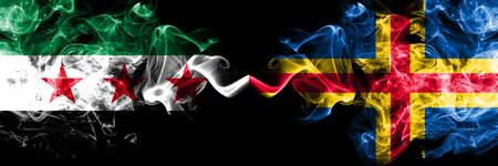 Syria vs Aland smoke flags placed side by side. Thick colored silky smoke flags of Syrian and Aland Stock Photo