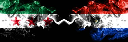 Syrian Arab Republic vs Paraguay, Paraguayan smoke flags placed side by side. Thick colored silky smoke flags of Syria opposition and Paraguay, Paraguayan Stock Photo