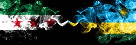Syrian Arab Republic vs Rwanda, Rwandan smoke flags placed side by side. Thick colored silky smoke flags of Syria opposition and Rwanda, Rwandan Stock Photo