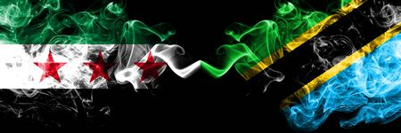 Syrian Arab Republic vs Tanzania, Tanzanian smoke flags placed side by side. Thick colored silky smoke flags of Syria opposition and Tanzania, Tanzanian Stock Photo