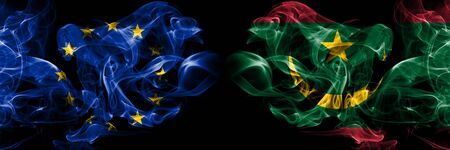 Eu, European union vs Mauritania, Mauritanian smoke flags placed side by side. Thick colored silky smokes abstract flags
