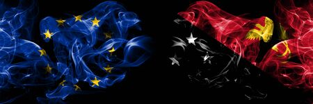Eu, European union vs Papua New Guinea smoke flags placed side by side. Thick colored silky smokes abstract flags