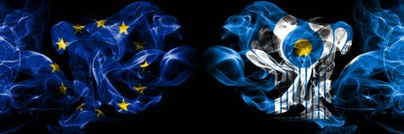 Eu, European union vs Commonwealth smoke flags placed side by side. Thick colored silky smokes abstract flags