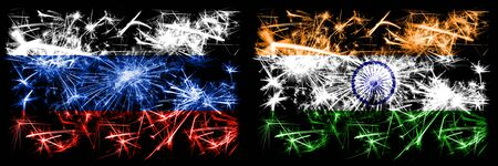 Russia, Russian vs India, Indian New Year celebration sparkling fireworks flags concept background. Combination of two states flags. Stock Photo