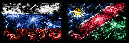 Russia, Russian vs Namibia, Namibian New Year celebration sparkling fireworks flags concept background. Combination of two states flags. Stock Photo