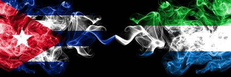 Cuba, Cuban vs Sierra Leone smoky mystic flags placed side by side. Thick colored silky travel abstract smokes banners