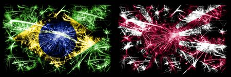 Brazil, Brazilian vs Japan, Japanese, sun New Year celebration sparkling fireworks flags concept background. Combination of two states flags. Stock Photo