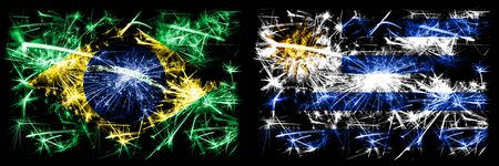 Brazil, Brazilian vs Uruguay, Uruguayan New Year celebration sparkling fireworks flags concept background. Combination of two states flags.