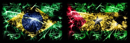 Brazil, Brazilian vs Sao Tome and Principe New Year celebration sparkling fireworks flags concept background. Combination of two states flags.