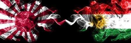 Japan rising sun naval vs Kurdistan, Kurdish smoky mystic states flags placed side by side. Thick colored silky travel abstract smokes banners Stock Photo