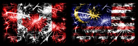 Canada, Canadian vs Malaysia, Malaysian New Year celebration sparkling fireworks flags concept background. Combination of two abstract states flags.