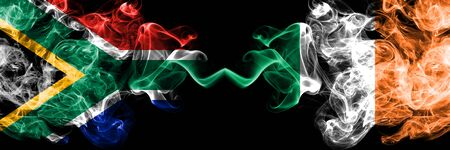 South Africa vs Ireland, Irish smoky mystic flags placed side by side. Thick colored silky abstract smoke flags concept