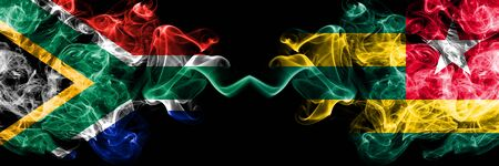 South Africa vs Togo, Togolese smoky mystic flags placed side by side. Thick colored silky abstract smoke flags concept Stock Photo