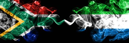 South Africa vs Sierra Leone smoky mystic flags placed side by side. Thick colored silky abstract smoke flags concept Stock Photo