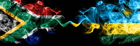 South Africa vs Rwanda, Rwandan smoky mystic flags placed side by side. Thick colored silky abstract smoke flags concept