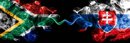 South Africa vs Slovakia, Slovakian smoky mystic flags placed side by side. Thick colored silky abstract smoke flags concept