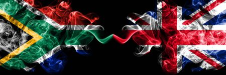 South Africa vs United Kingdom, British smoky mystic flags placed side by side. Thick colored silky abstract smoke flags concept of Britain, England Stock fotó