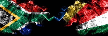 South Africa vs Seychelles, Seychelloise smoky mystic flags placed side by side. Thick colored silky abstract smoke flags concept