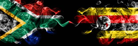 South Africa vs Uganda, Ugandan smoky mystic flags placed side by side. Thick colored silky abstract smoke flags concept