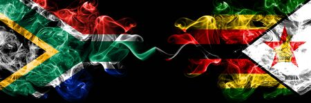 South Africa vs Zimbabwe, Zimbabwean smoky mystic flags placed side by side. Thick colored silky abstract smoke flags concept