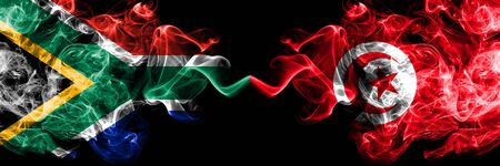 South Africa vs Tunisia, Tunisian smoky mystic flags placed side by side. Thick colored silky abstract smoke flags concept