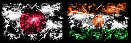 Japan, Japanese vs Niger, Nigerian New Year celebration sparkling fireworks flags concept background. Combination of two abstract states flags. Stock fotó