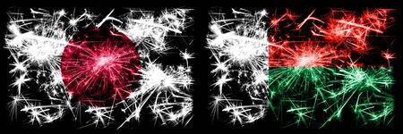 Japan, Japanese vs Madagascar, Madagascan New Year celebration sparkling fireworks flags concept background. Combination of two abstract states flags. Stock fotó