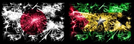 Japan, Japanese vs Sao Tome and Principe New Year celebration sparkling fireworks flags concept background. Combination of two abstract states flags. Stock fotó