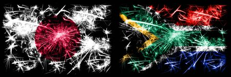Japan, Japanese vs South Africa, African New Year celebration sparkling fireworks flags concept background. Combination of two abstract states flags. Stock fotó