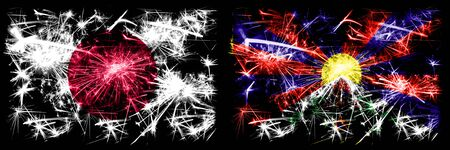 Japan, Japanese vs Tibet, Tibetan New Year celebration sparkling fireworks flags concept background. Combination of two abstract states flags.