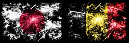 Japan, Japanese vs Belgium, Belgian New Year celebration sparkling fireworks flags concept background. Combination of two abstract states flags.