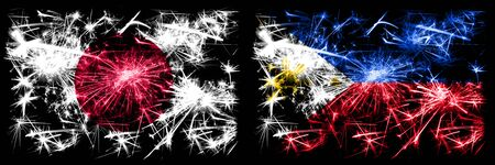 Japan, Japanese vs Philippines, Filipino New Year celebration sparkling fireworks flags concept background. Combination of two abstract states flags. Stock Photo