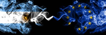 Argentina vs European Union, EU smoky mystic fire flags placed side by side. Thick colored silky abstract smoke flags concept