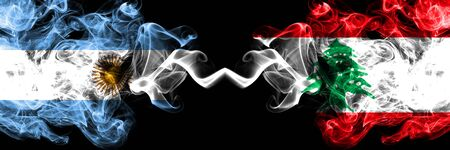 Argentina vs Lebanon, Lebanese smoky mystic fire flags placed side by side. Thick colored silky abstract smoke flags concept Stock Photo