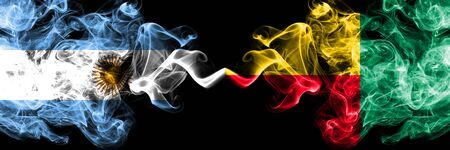 Argentina vs Benin, Beninese smoky mystic fire flags placed side by side. Thick colored silky abstract smoke flags concept