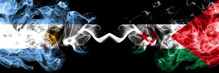 Argentina vs Sahrawi smoky mystic fire flags placed side by side. Thick colored silky abstract smoke flags concept