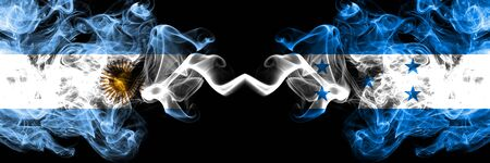 Argentina vs Honduras, Honduran smoky mystic fire flags placed side by side. Thick colored silky abstract smoke flags concept