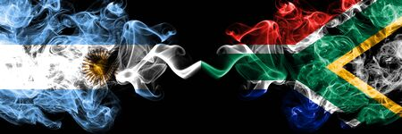 Argentina vs South Africa, African smoky mystic fire flags placed side by side. Thick colored silky abstract smoke flags concept