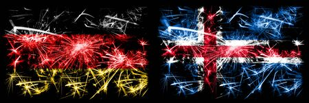 Germany, German vs Iceland, Icelandic New Year celebration travel sparkling fireworks flags concept background. Combination of two abstract states flags.